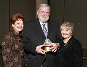 Phil Hatlen holding his Wings of Freedom Award, Patricia Williams of the Hatlen Center (left) and Betsy Wada.