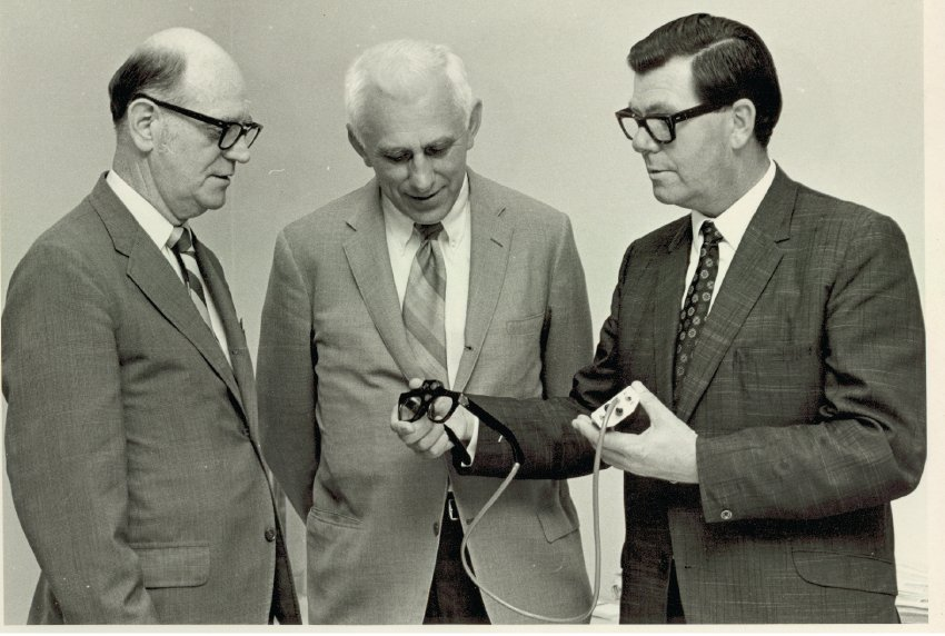 Eichorn, Blasch, and Kay looking at a Sonic Guide, ca. 1970
