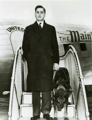 Morris Frank and Buddy exit from an airplane