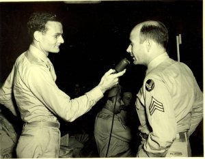 Warren Bledsoe in U.S./Army Air Corps uniform being interviewed by another soldier, ca. 1943