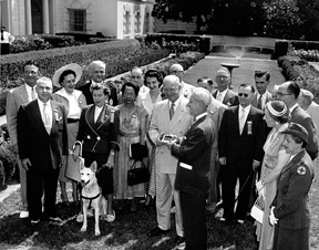 President Dwight D. Eisenhower is shown with Roy Kumpe in the White House Rose Garden.