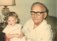 James Max Woolly with granddaughter Laura Woolly (1976)