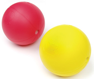 Two electronic sound balls--one red and the other yellow.