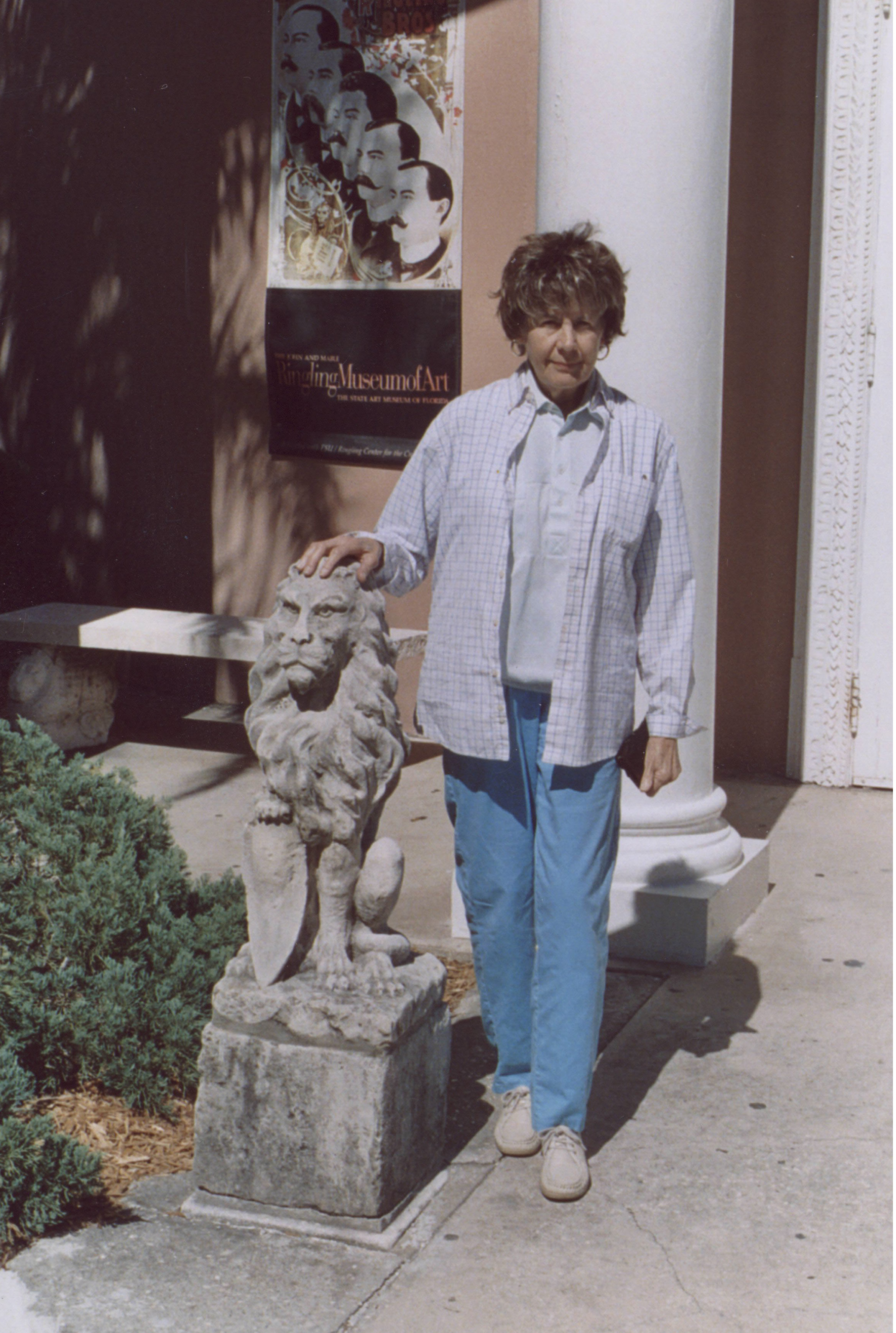 Lou Alonso standing next to a stone lion