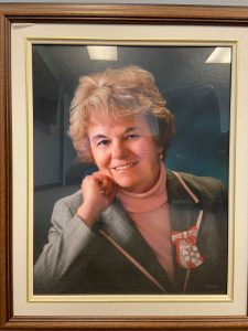 Portrait of Ann MacCuspie wearing her Order of Canada ribbon